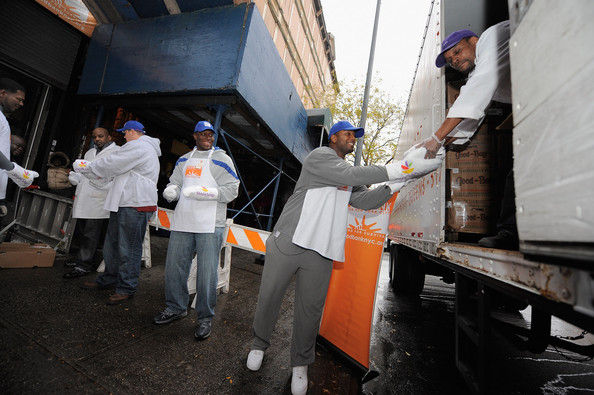New York Giants Team Members Deliver Thanksgiving Dinner To The Food Bank For NYC
