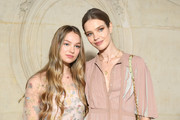 Natalia Vodianova (R) and her daughter attend the Christian Dior show as part of the Paris Fashion Week Womenswear Fall/Winter 2019/2020 on February 26, 2019 in Paris, France.