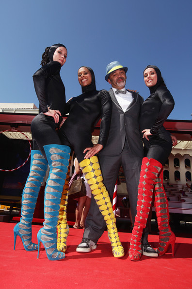 Designer Christian Louboutin and The Loubi's Angels attend 'Le Carrosse Noir And The Loubi's Angels' presented by Christian Louboutin at Palm Beach Casino during the 63rd Annual Cannes Film Festival on May 17, 2010 in Cannes, France.