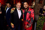 Christian Louboutin and Quincy Brown attend the Loubicircus Party by Christian Louboutin at Musee des Arts Forains as part of Paris Fashion Week on June 19, 2019 in Paris, France.