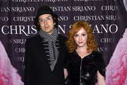 "Geoffrey Arend and Christina Hendricks attend Christian Siriano celebrates the release of his book ""Dresses To Dream About"" at the Rizzoli Flagship Store on November 8, 2017 in New York City."