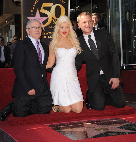 Christina Aguilera Singer Christina Aguilera, Screen Gems' Clint Culpepper  and  Irving Azoff  pose as Christina Aguilera is honored with a star on The Hollywood Walk Of Fame on November 15, 2010 in Hollywood, California.