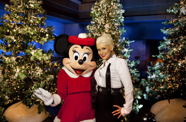 Christina Aguilera In this handout photo provided by Disney Parks, Christina Aguilera poses with Minnie Mouse following the taping of the 2011 Disney Parks Christmas Day Parade at Disney's Grand Californian Hotel & Spa on November 06, 2011 in Anaheim, California. The performance airs on Christmas Day (December 25, 2011).
