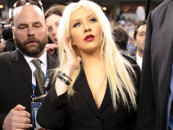 Christina Aguilera Singer Christina Aguilera looks on prior to singing the National Anthem during Super Bowl XLV at Cowboys Stadium on February 6, 2011 in Arlington, Texas.