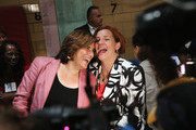 Democratic mayoral candidate Christine Quinn (R) and her wife Kim Catullo embrace before casting their votes in the primary election for New York City mayor on September 10, 2013 in New York City.  Quinn, trailing in the polls, is hoping to garner enough votes to compete in a runoff election to be the Democratic candidate.