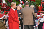 (L-R) Princess Charlene Of Monaco, Princess Gabriella of Monaco, Prince Albert II of Monaco and  Prince Jacques of Monaco attend the annual Christmas gifts distribution at Monaco Palace on December 14, 2016 in Monaco, Monaco.