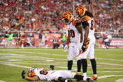 Cedric Peerman #30 and Cobi Hamilton #87 check on wide receiver James Wright #86 of the Cincinnati Bengals as he lies on the field after an injury during the fourth quarter of the preseason NFL game against the Arizona Cardinals at the University of Phoenix Stadium on August 24, 2014 in Glendale, Arizona.