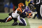 Running Back Danny Woodhead #39 of the Baltimore Ravens carries the ball as he is tackled by strong safety Shawn Williams #36 of the Cincinnati Bengals in the third quarter at M&T Bank Stadium on December 31, 2017 in Baltimore, Maryland.
