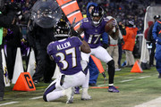 Wide Receiver Mike Wallace #17 and running back Javorius Allen #37 of the Baltimore Ravens celebrate after touchdown in the fourth quarter against the Cincinnati Bengals at M&T Bank Stadium on December 31, 2017 in Baltimore, Maryland.