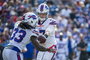 Josh Allen #17 hands the ball off to Chris Ivory #33 of the Buffalo Bills during the first quarter of a preseason game against the Cincinnati Bengals at New Era Field on August 26, 2018 in Orchard Park, New York.