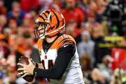Andy Dalton #14 of the Cincinnati Bengals rolls out of the pocket during the second quarter of the game against the Kansas City Chiefs at Arrowhead Stadium on October 21, 2018 in Kansas City, Kansas.