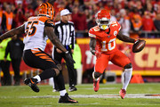 Tyreek Hill #10 of the Kansas City Chiefs begins to make a hard cut in in front of Vontaze Burfict #55 of the Cincinnati Bengals during the first quarter of the game at Arrowhead Stadium on October 21, 2018 in Kansas City, Kansas.