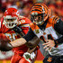 Chris Jones Photos - Andy Dalton #14 of the Cincinnati Bengals begins to hand the ball off with heavy pressure from Chris Jones #95 of the Kansas City Chiefs during the first quarter of the game at Arrowhead Stadium on October 21, 2018 in Kansas City, Kansas. - Chris Jones Photos - 5 of 626