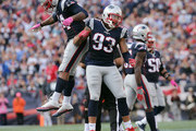 Dont'a Hightower #54 of the New England Patriots and Jabaal Sheard #93 celebrate a sack against the Cincinnati Bengals in the second half at Gillette Stadium on October 16, 2016 in Foxboro, Massachusetts.
