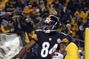 Antonio Brown #84 of the Pittsburgh Steelers celebrates after a 12 yard touchdown pass against the Cincinnati Bengals during the game on December 15, 2013 at Heinz Field in Pittsburgh, Pennsylvania.