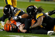 Jeff Driskel #6 of the Cincinnati Bengals is sacked by Bud Dupree #48 of the Pittsburgh Steelers and Cameron Heyward #97 in the third quarter during the game at Heinz Field on December 30, 2018 in Pittsburgh, Pennsylvania.