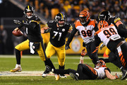 Ben Roethlisberger #7 of the Pittsburgh Steelers attempts a pass under pressure in the second half during the game against the Cincinnati Bengals at Heinz Field on December 30, 2018 in Pittsburgh, Pennsylvania.