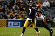 Ben Roethlisberger #7 of the Pittsburgh Steelers is hit as he throws by Shawn Williams #36 of the Cincinnati Bengals in the first half during the game at Heinz Field on December 30, 2018 in Pittsburgh, Pennsylvania.