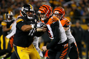 Jeff Driskel #6 of the Cincinnati Bengals is pressured by Cameron Heyward #97 of the Pittsburgh Steelers in the third quarter during the game at Heinz Field on December 30, 2018 in Pittsburgh, Pennsylvania.