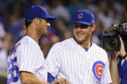 Cole Hamels #35 of the Chicago Cubs (L) is congratulated by Anthony Rizzo #44 after a complete game win against the Cincinnati Reds at Wrigley Field on August 23, 2018 in Chicago, Illinois. The Cubs defeated the Reds 7-1.