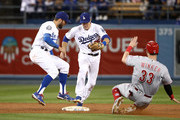 Chase Utley #26 of the Los Angeles Dodgers moves to step on the second base for the force out on Jesse Winker #33 of the Cincinnati Reds after colliding with teammate Chris Taylor #3 in the sixth inning during the MLB game at Dodger Stadium on May 11, 2018 in Los Angeles, California. The Reds defeated the Dodgers 6-2.