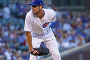 Cole Hamels #35 of the Chicago Cubs looks for the signs on his way to a complete game win over the Cincinnati Reds at Wrigley Field on August 23, 2018 in Chicago, Illinois. The Cubs defeated the Reds 7-1.