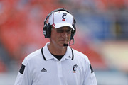Head coach Tommy Tuberville of the Cincinnati Bearcats watches first quarter action against the Miami Hurricanes on October 11, 2014 at Sun Life Stadium in Miami Gardens, Florida.