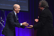"""DreamWorks Animation CEO Jeffrey Katzenberg and Fox Filmed Entertainment Chairman and Chief Executive Officer Jim Gianopulos speak onstage at the 2015 Will Rogers """"Pioneer of the Year"""" Dinner Honoring Jim Gianopulos at Caesars Palace during CinemaCon, the official convention of the National Association of Theatre Owners, on April 22, 2015 in Las Vegas, Nevada."""