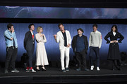 """(L-R) Actors Callum Turner, Ezra Miller, Alison Sudol, Will Arnett, Dan Fogler, Eddie Redmayne and Katherine Waterston speak onstage during CinemaCon 2018 Warner Bros. Pictures Invites You to """"The Big Picture"""", an Exclusive Presentation of our Upcoming Slate at The Colosseum at Caesars Palace during CinemaCon, the official convention of the National Association of Theatre Owners, on April 24, 2018 in Las Vegas, Nevada."""