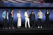 (L-R) Actors Callum Turner, Ezra Miller, Alison Sudol, Will Arnett, Dan Fogler, Eddie Redmayne and Katherine Waterston speak onstage during CinemaCon 2018 Warner Bros. Pictures Invites You to ?The Big Picture?, an Exclusive Presentation of our Upcoming Slate at The Colosseum at Caesars Palace during CinemaCon, the official convention of the National Association of Theatre Owners, on April 24, 2018 in Las Vegas, Nevada.