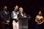 (L-R) Gabriel Luna, Mackenzie Davis, Linda Hamilton, and Natalia Reyes accept the CinemaCon Ensemble Award onstage at The CinemaCon Big Screen Achievement Awards Brought to you by The Coca-Cola Company at OMNIA Nightclub at Caesars Palace during CinemaCon, the official convention of the National Association of Theatre Owners, on April 4, 2019 in Las Vegas, Nevada.