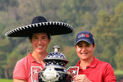 Carlota Ciganda of Spain is presented with the winners trophy by Lorena Ochoa following the final round of the Citibanamex Lorena Ochoa Invitational Presented By Aeromexico and Delta at Club de Golf Mexico on November 13, 2016 in Mexico City, Mexico.