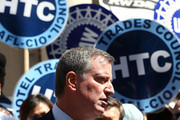 Democratic mayoral nominee Bill de Blasio stands in front of union signs at a news conference where New York City Council Speaker and former mayoral candidate Christine Quinn endorsed de Blasio outside City Hall on September 17, 2013 in New York City. De Blasio will face Republican Joseph Lhota in the general mayoral election November 5, 2013, with the winner succeeding current Mayor Michael Bloomberg.