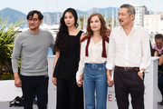 """(L-R) Jeong Jinyoung, Kim Minhee, Isabelle Huppert and Hong SangSoo attend the """"Claire's Camera (Keul-Le-Eo-Ui-Ka-Me-La)"""" photocall during the 70th annual Cannes Film Festival at Palais des Festivals on May 21, 2017 in Cannes, France."""