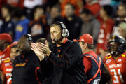 Head coach Randy Edsall of the Maryland Terrapins celebrates after the Terrapins intercepted a Clemson Tigers pass during the first half at Byrd Stadium on October 15, 2011 in College Park, Maryland.