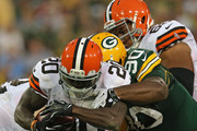Montario Hardesty #20 of the Cleveland Browns is tackled by A.J. Hawk #50 and B.J. Raji #90 of the Green Bay Packers during a preseason game at Lambeau Field on August 16, 2012 in Green Bay, Wisconsin.