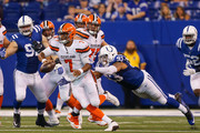 Jabaal Sheard #93 of the Indianapolis Colts tackles DeShone Kizer #7 of the Cleveland Browns during the second half at Lucas Oil Stadium on September 24, 2017 in Indianapolis, Indiana.