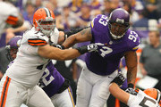 John Greco #77 of the Cleveland Browns puts the pressure on Kevin Williams #93 of the Minnesota Vikings on September 22, 2013 at Mall of America Field at the Hubert Humphrey Metrodome in Minneapolis, Minnesota.