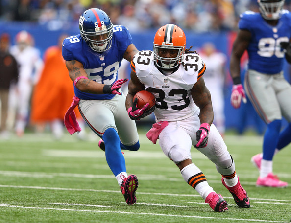 Cleveland browns runs with the ball as michael boley 59 of the new