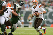 Quarterback Jason Campbell #17 of the Cleveland Browns gets away from pressure during the first half against the New York Jets at MetLife Stadium on December 22, 2013 in East Rutherford, New Jersey.