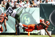 Chris Ivory #33 of the New York Jets is hit by K'Waun Williams #36 of the Cleveland Browns during the third quarter at MetLife Stadium on September 13, 2015 in East Rutherford, New Jersey. The Jets won 31-10.