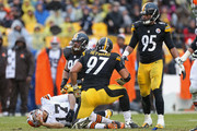 Cameron Heyward #97 of the Pittsburgh Steelers kneels after sacking Jason Campbell #17 of the Cleveland Browns during the game at Heinz Field on December 29, 2013 in Pittsburgh, Pennsylvania.  The Steelers defeated the Browns 20-7.