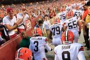 Quarterbacks Johnny Manziel #2  and Connor Shaw #9 of the Cleveland Browns take the field before the start of a preseason game against the Washington Redskins at FedExField on August 18, 2014 in Landover, Maryland.