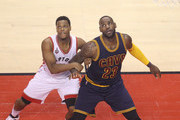 LeBron James #23 of the Cleveland Cavaliers anticipates a rebound as he positions himself against Kyle Lowry #7 of the Toronto Raptors in Game Four of the Eastern Conference Finals during the 2016 NBA Playoffs at the Air Canada Centre on May 23, 2016 in Toronto, Ontario, Canada.  NOTE TO USER: User expressly acknowledges and agrees that, by downloading and or using this photograph, User is consenting to the terms and conditions of the Getty Images License Agreement.