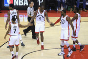 Bismack Biyombo #8 of the Toronto Raptors high fives teammates during the second half against the Cleveland Cavaliers in game three of the Eastern Conference Finals during the 2016 NBA Playoffs at Air Canada Centre on May 21, 2016 in Toronto, Canada.