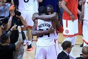 Patrick Patterson #54 and Bismack Biyombo #8 of the Toronto Raptors hug after defeating the Cleveland Cavaliers in game four of the Eastern Conference Finals during the 2016 NBA Playoffs at the Air Canada Centre on May 23, 2016 in Toronto, Ontario, Canada. NOTE TO USER: User expressly acknowledges and agrees that, by downloading and or using this photograph, User is consenting to the terms and conditions of the Getty Images License Agreement.