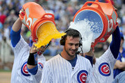 Kris Bryant (C) of the Chicago Cubs gets gets a gatorade bath from David Ross (L) and Anthony Rizzo (R) after hitting a walk-off home run against the Cleveland Indians during the ninth inning on August 24, 2015 at Wrigley Field in Chicago, Illinois. The Cubs won 2-1.