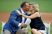 Newly inducted Hall of Famer Jim Thome kisses his wife Andrea Thome during a ceremony before the game between the Chicago White Sox and the Cleveland Indians at Guaranteed Rate Field on August 11, 2018 in Chicago, Illinois.