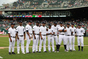 "The Detroit Tigers marked ""Fiesta Tigres"" celebrating the contribution of Hispanic and Latino players including (L-R) Rafael Belliard #17 Al Alburquerque #62 Joaquin Benoit #53 Wilson Betemit #20 Jhonny Peralta #27 Ramon Santoago #39 Jose Valverde #46 Miguel Cabrera #24 Carlos Guillen #9 Victor Martinez #41 and Magglio Ordonez #30 prior to the start of the game against the Cleveland Indians at Comerica Park on August 20, 2011 in Detroit, Michigan. The Tigers defeated the Indians 10-1."