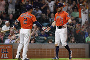 Derek Fisher #21 of the Houston Astros is congratulated by Alex Bregman #2 of the Houston Astros after scoring in the seventh inning against the Cleveland Indians at Minute Maid Park on May 18, 2018 in Houston, Texas.
